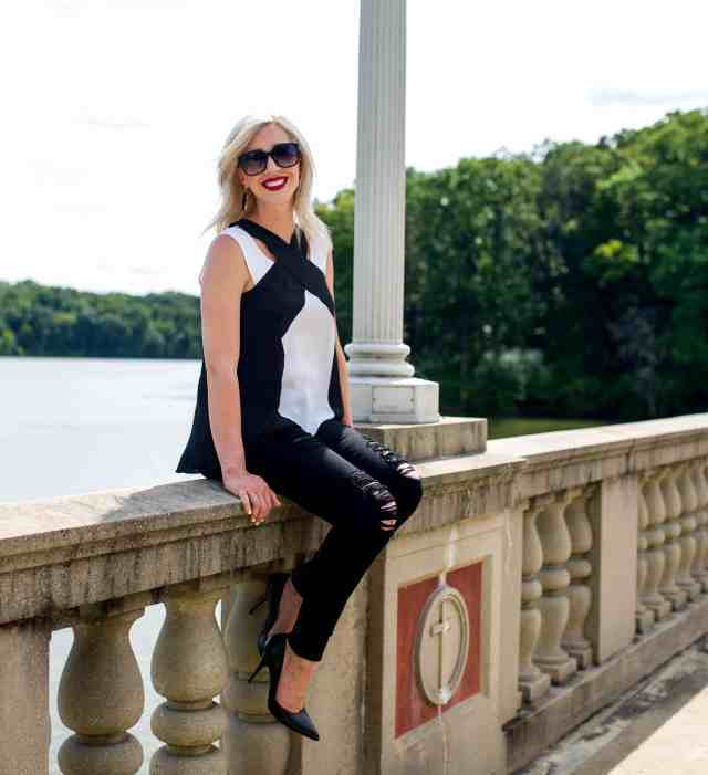 bcbg black & white top, black ripped jeans, pumps, red lip