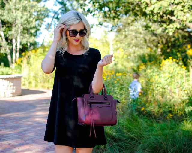 black dress, burgundy handbag