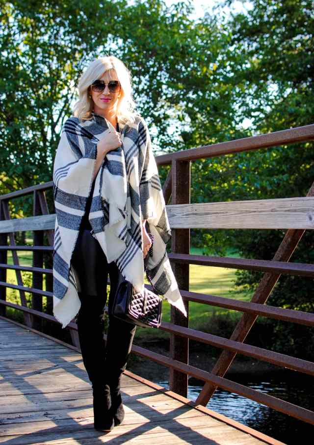 poncho, faux leather leggings