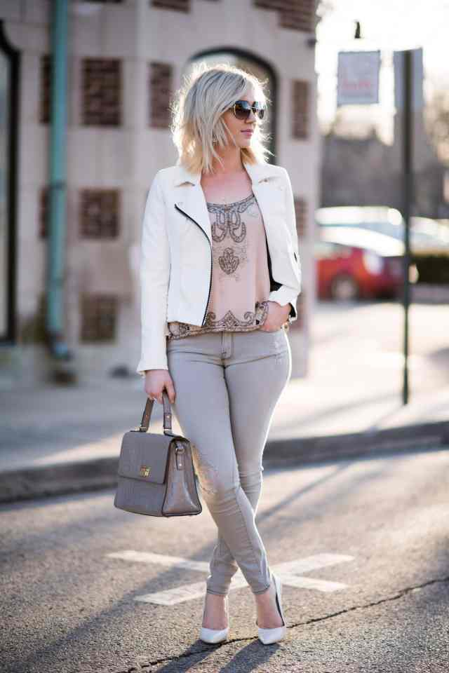 white leather jacket, grey jeans