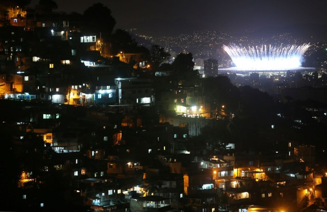 Fireworks explode over Maracana Stadium with the Prazeres 'favela' community in the foreground during opening ceremonies for the Rio 2016 Olympic Games on August 5, 2016 in Rio de Janeiro, Brazil.