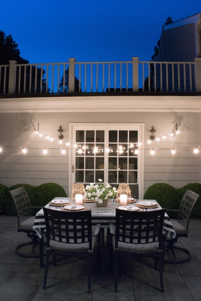 Cross a pair of string lights over your patio for a dreamy outdoor dining spot.