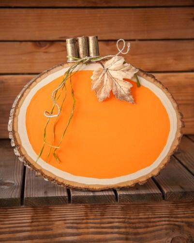 Outdoor Fall Decorating Ideas - orange painted wood slice pumpkin diy