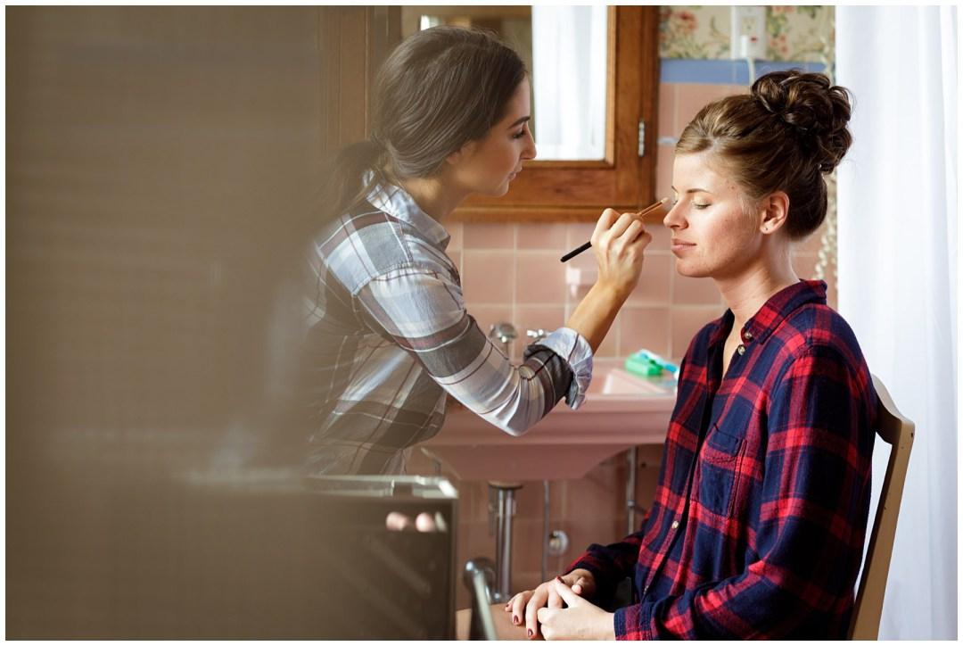 makeup artist at work on bride