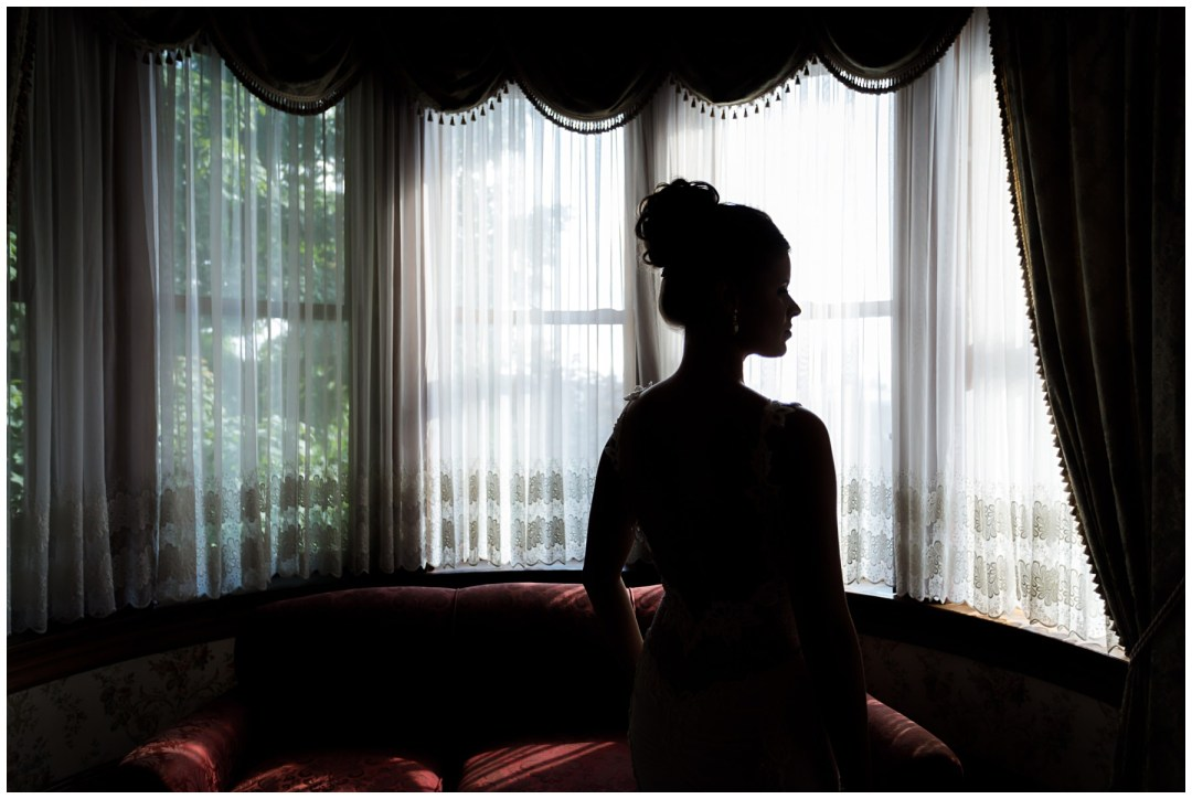 silhouette of bride in historic hotel