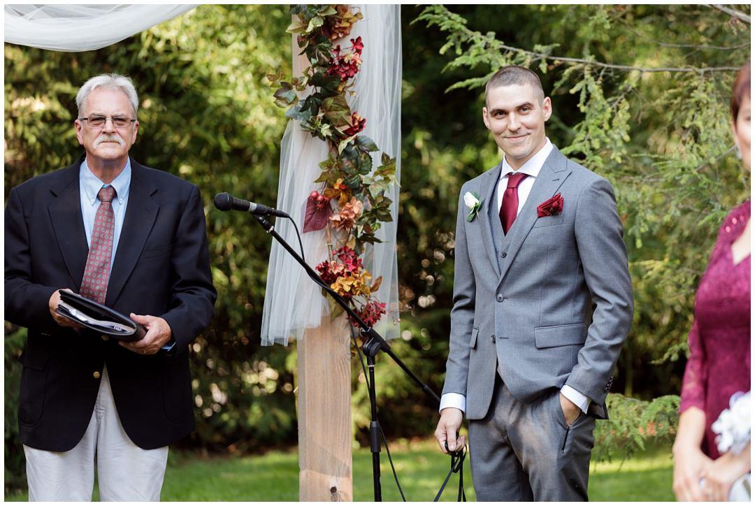 great groom reaction to bride walking down aisle
