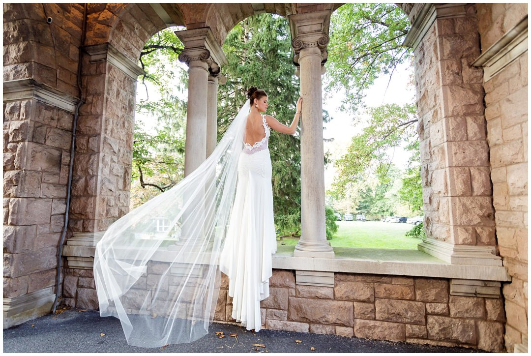 bridal portrait with flowing veil and historic archways
