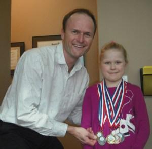 Chiropractor Dr Tim with little award winner