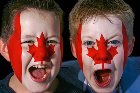Kids with painted faces for Canada Day