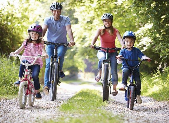 Eco conscious family riding bikes
