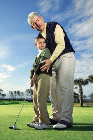 kid golfing with grandpa