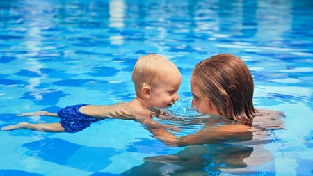 mom swimming with baby