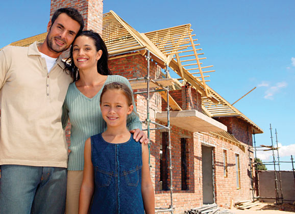 family in front of home new construction,buildingy our own home