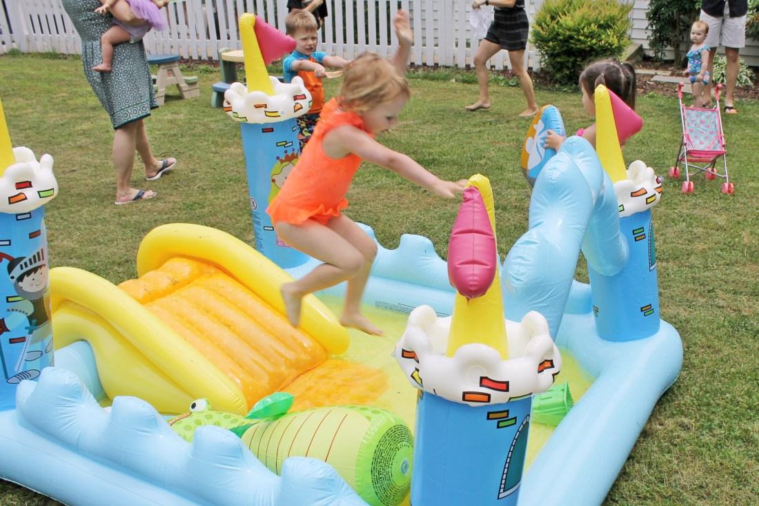 rosie at inflatable pool