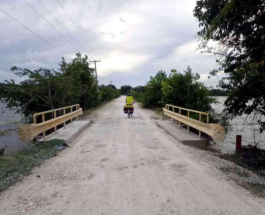 Bicycle touring through Belize - Cycling toward Crooked Tree Wildlife Sanctuary