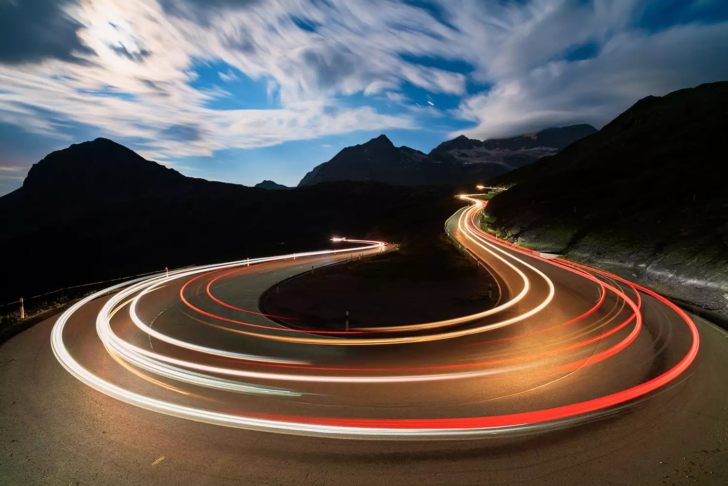Car lights, Bernina Pass, Switzerland - The Internet Tips