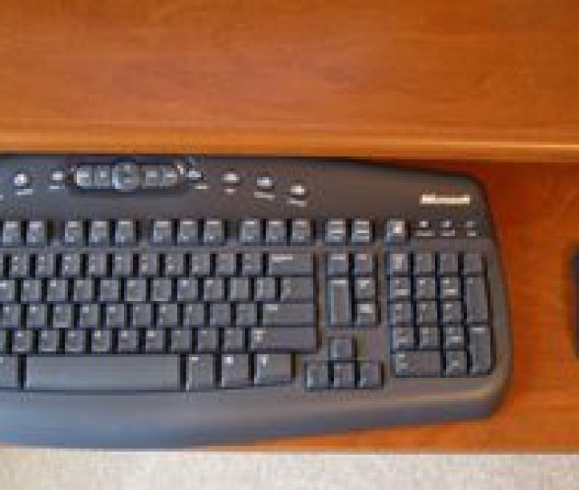 Picture Of A Keyboard And Mouse On A Computer Desk