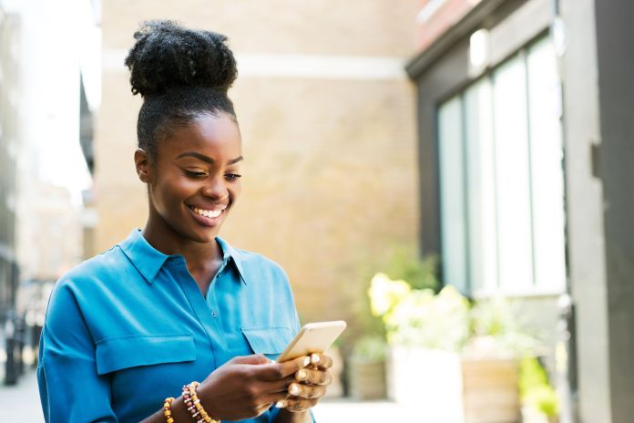 Image result for black person using phone