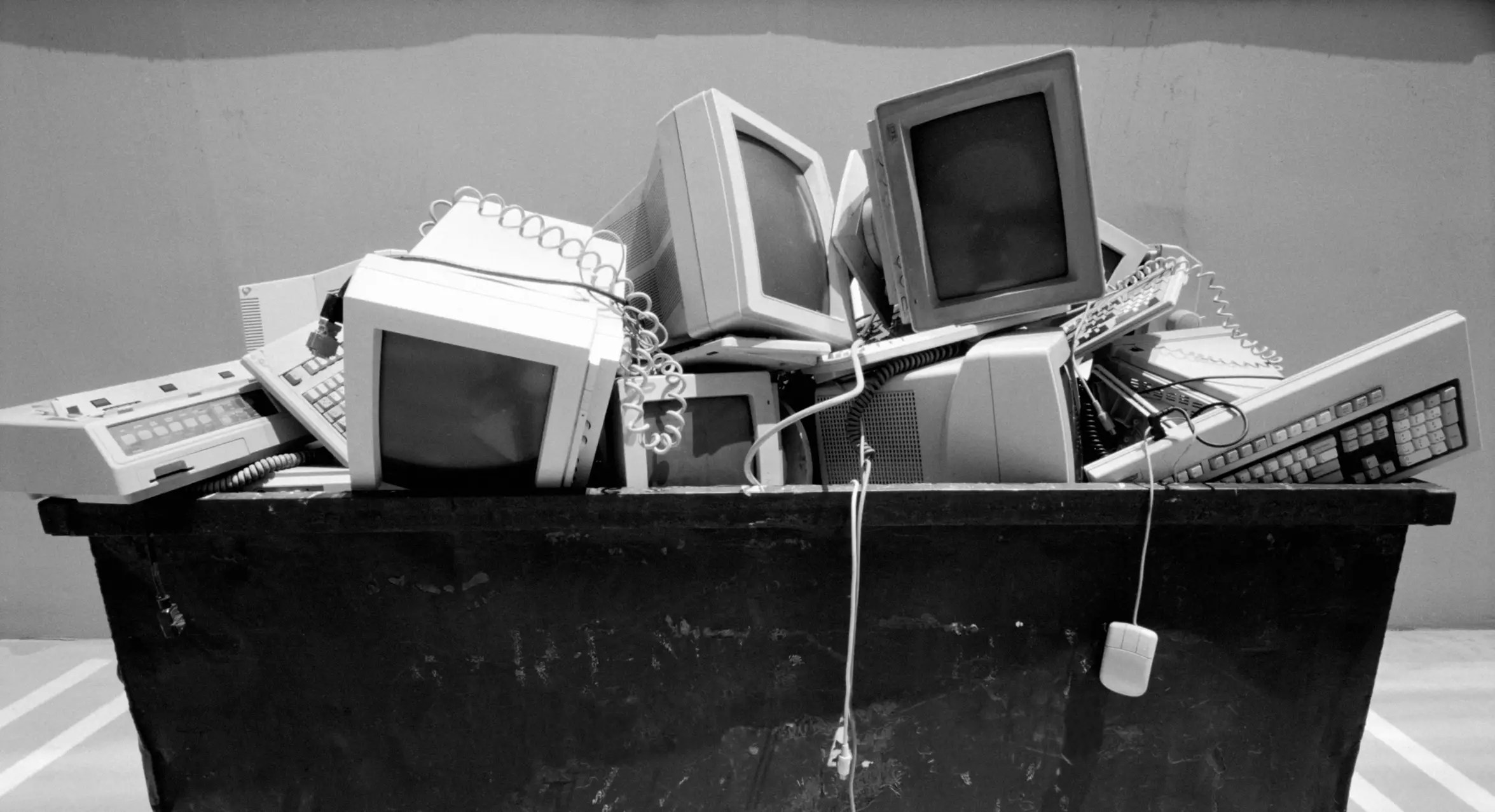 Photo of a garbage container full of old computer parts - The Internet Tips