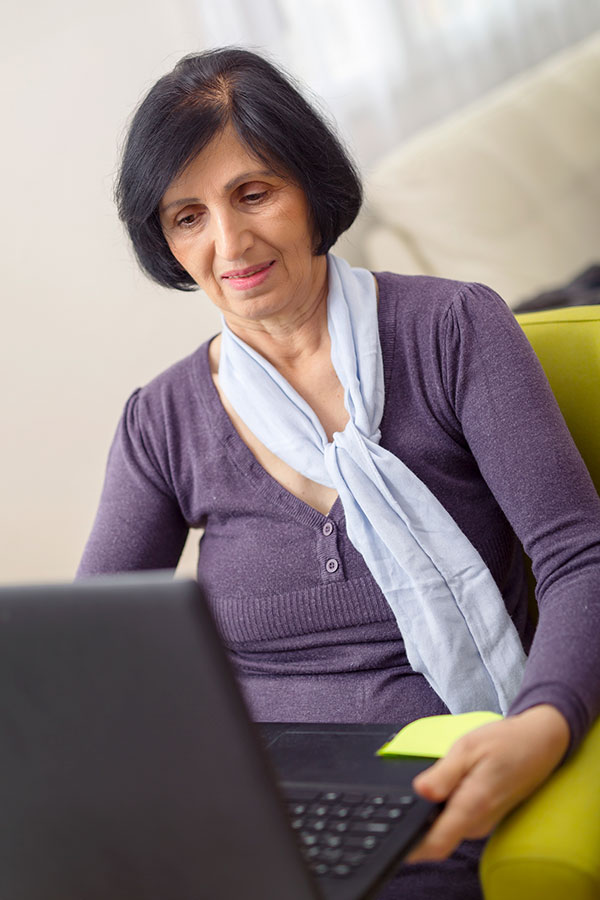 Older woman at home using a laptop computer