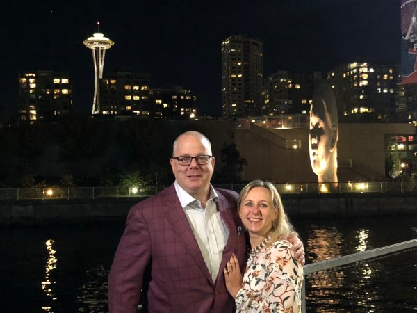 Andrew and Alycen Farell in front of the Space Needle at night
