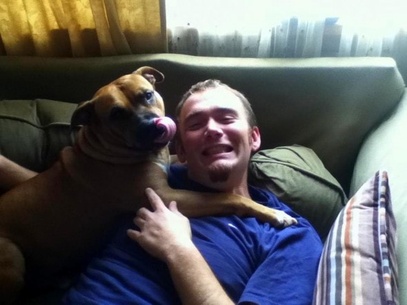 """This guy used to be a bit scared of pit bulls, but that was before he met Spartacus, the 65-lb lap beast who likes to """"claim"""" people by laying on their chests and not letting them leave."""