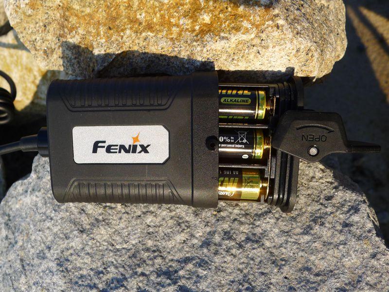 Fenix HP05 - battery pack & reflective sticker.