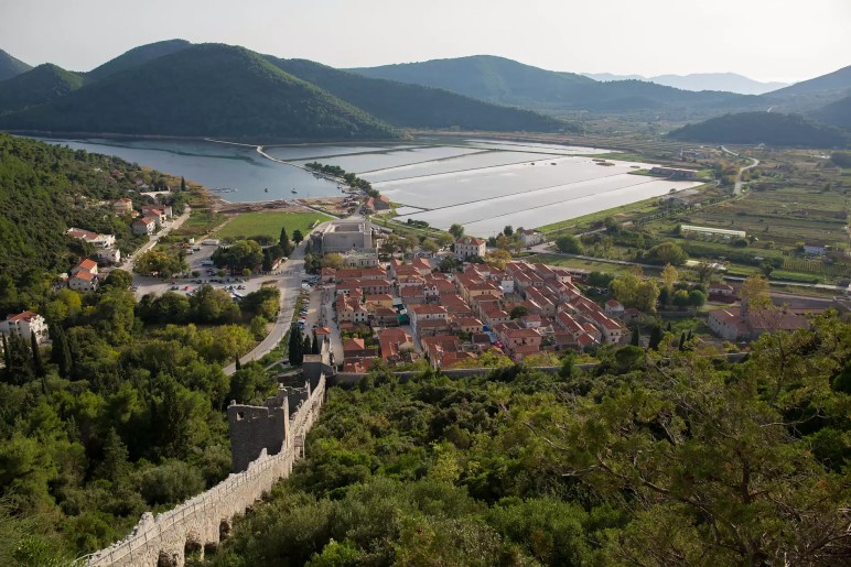 From high on the Ston city wall you can see across the valley to a harbor and the salt shallows.