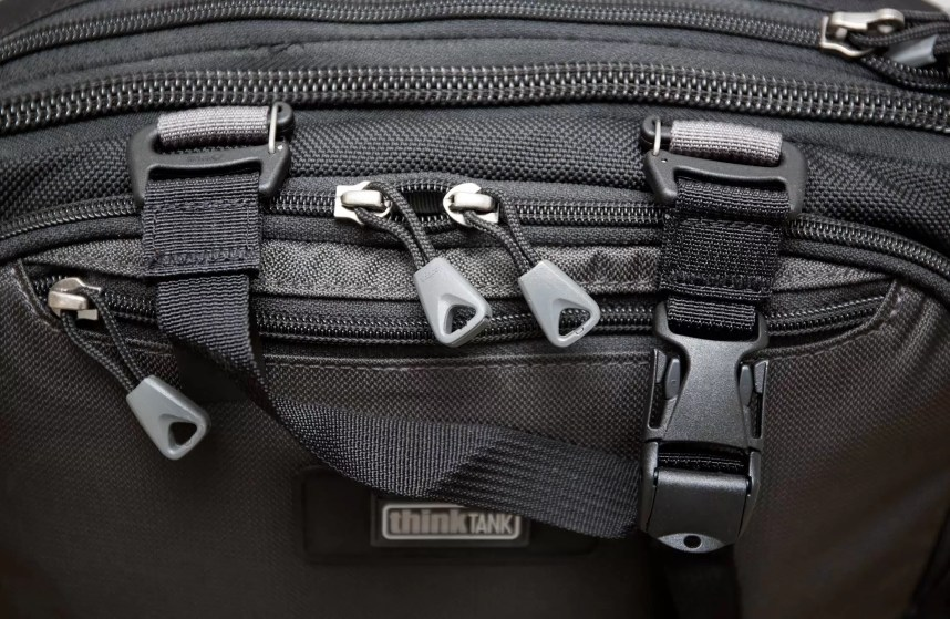 The upper tripod strap. These straps can be quickly detached to reduce the chance of snags while not in use.