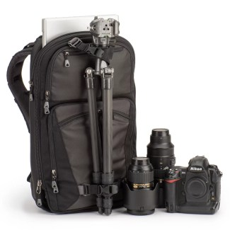 The tripod straps in use with a full-size tripod. With smaller tripods, the lower legs can rest in the middle pocket. Image courtesy of ThinkTank.