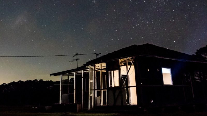 Remote Farmstead under Starry Sky