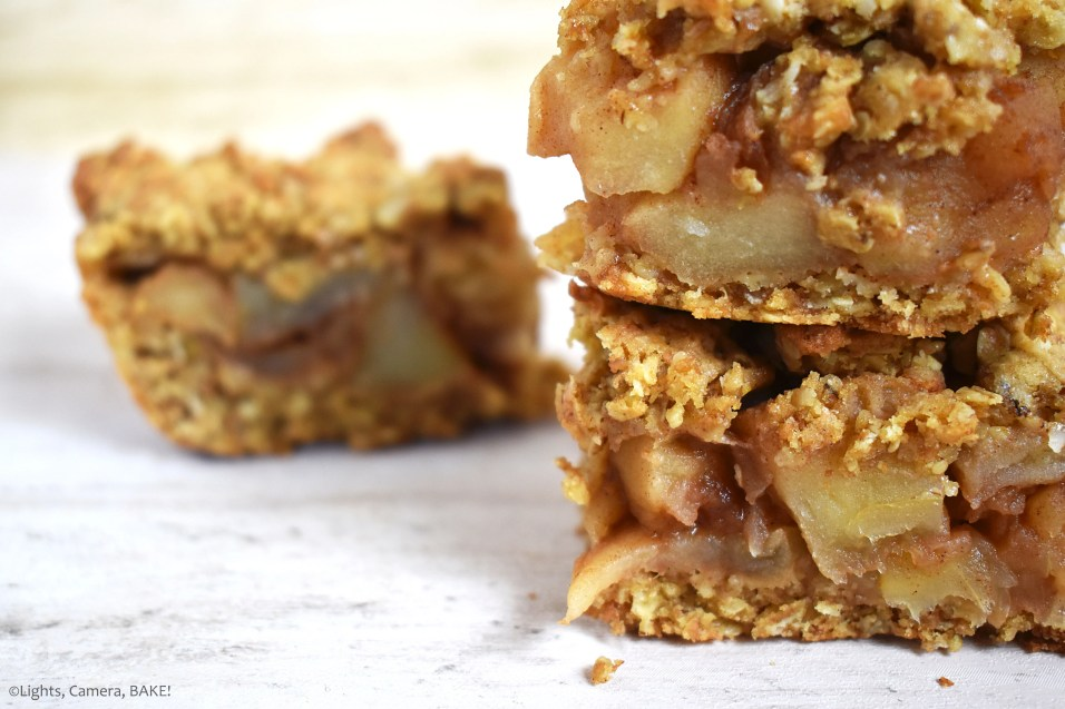 This is an Apple Crumble Slice. The slice uses a crumble base with cooked apples and cinnamon spice for the filling. #applecrumble #appleslice #applecrumbleslice #appleoatbars