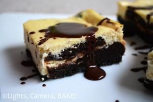 Chocolate Brownie Swirl Cheesecake Slice. Chocolate cookie base, creamy, tangy, vanilla, baked cheesecake with rich, chocolate brownie swirled through the bottom cheesecake layer. So good! #browniecheesecake #recipe #cheesecakebars