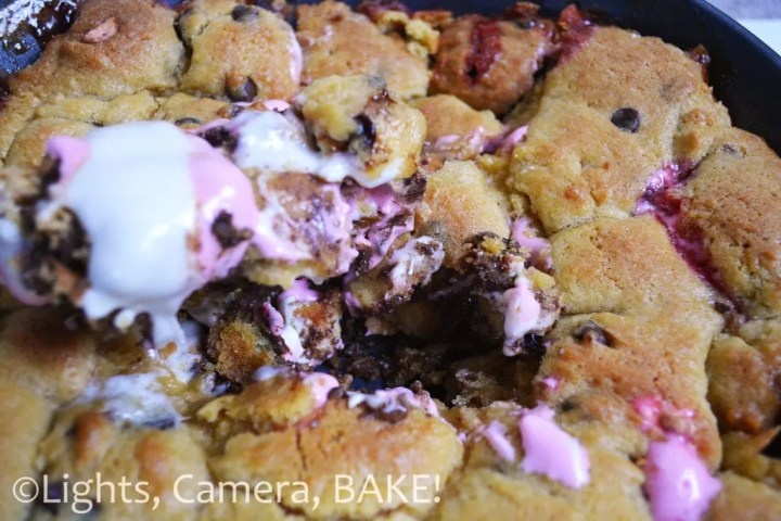 S'mores Cookie Pie is the definition of comfort food! Rich, buttery and packed full of chocolate, marshmallows and crushed digestives. This is an ooey gooey treat to die for! Click the photo for the #recipe . #cookiepie #smores
