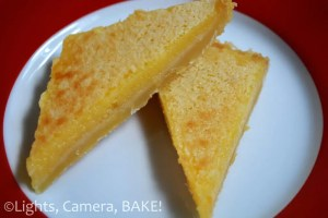 Sticky Lemon Slice. A shortbread like base with a sweet yet tangy lemon topping! The texture is very melt in the mouth, almost like a custard! Click the the photo for the #recipe #stickylemonslice #baking