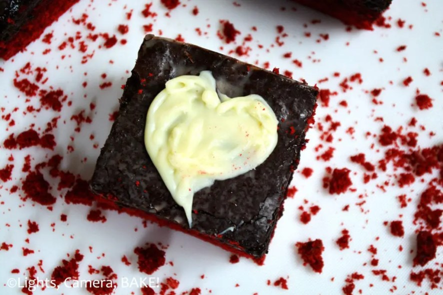 Red Velvet Truffle Bars. Red velvet chewy, soft and slightly cakey red velvet cookie bars topped with a thick layer of Oreo Truffle, chocolate and topped with white chocolate hearts. #redvelvettrufflebars #redvelvetoreotruffle #valentinesdaydessert
