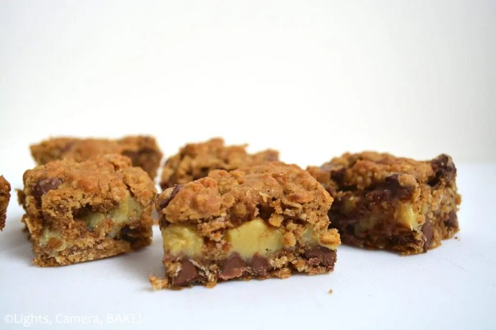Caramel Spiced Oat Bars are a soft and pillowy, chocolate chip, lightly spiced oat bar filled with the best buttery caramel ever. They're gooey with a lightly crisp outside. #spicedoatbars #carameloatbars #chocolatecaramelbars #gooeyoatbars