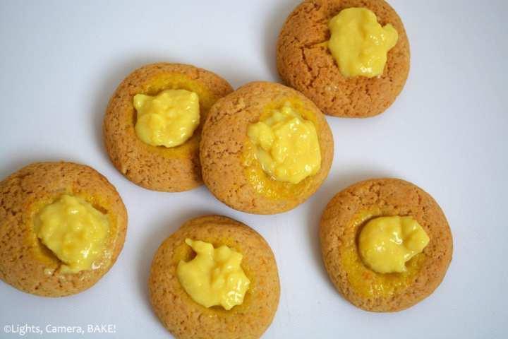 Custard Thumbprint Cookies are a melt in the mouth custard cookie with a custard filling in the thumbprint. If you love vanilla or custard, these are for you! #custardcookies #thumbprintcookies #thumbprintcookiesrecipe