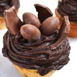 Jumbo Easter Egg Cupcakes are a vanilla cupcake filled with a marshmallow Easter egg baked inside, topped with chocolate frosting and finished off with broken pieces of chocolate Easter bunnies and Easter eggs.