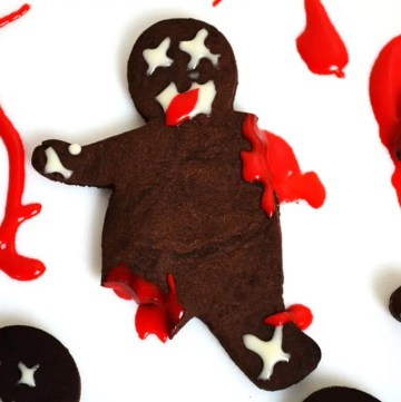 Zombie Chocolate Shortbread Cookies are a chocolate shortbread cut out like a gingerbread man and then 'chopped' up to create a zombie effect and then covered in a red, white chocolate ganache for the blood!