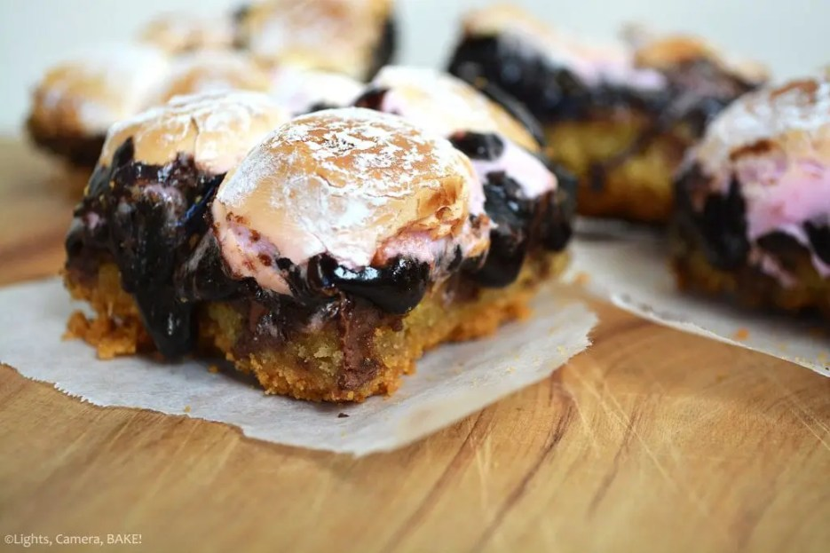 Brookie S'mores Bars are a combination of soft and chewy chocolate chip cookies and rich and fudgy brownies sandwiched in between crushed digestive biscuits (Graham Crackers) and a layer of toasted marshmallows.