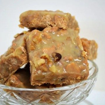 Caramel and Walnut fudge is a no bake, quick and easy fudge recipe using just six ingredients! This fudge uses a rich and sweet caramel recipe mixed with crushed digestives (graham crackers) and chopped walnuts.