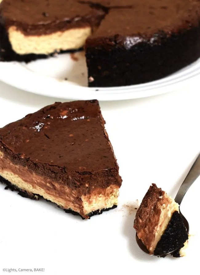 Vertical photo of the Peanut Butter Chocolate Cheesecake. This is a three layer,baked cheesecake. An Oreo crust, a peanut butter cheesecake and chocolate cheesecake. Creamy, salty and sweet. This is the chocolate and peanut butter lovers cheesecake and tastes just like a Reese's peanut butter cup. #chocolatepeanutbuttercheesecake