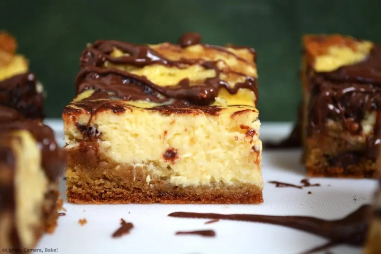 Peanut Butter Cheesecake Blondies are soft and gooey blondies topped with a creamy cheesecake and swirled with a chocolate peanut butter swirl. #peanutbutterchocolate #cheesecakeblondies #peanutbutterblondies
