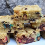 Salted Caramel M&M Cookie Bars are gooey and chewy chocolate chip, M&M cookie bars with a layer of caramel sauce running through the middle for the ultimate caramel and chocolate, comfort food recipe. #saltedcaramel #mandmcookiebars #cookiebars #saltedcaramelcookiebars #caramelcookiebars