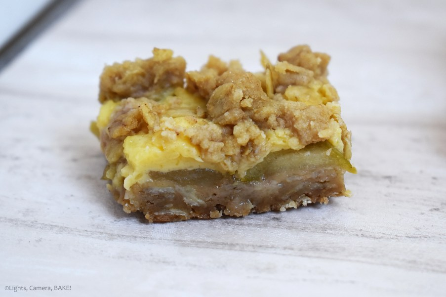 Apple and Custard Crumble Bars consist of chewy and crisp crumble base with a cooked apple and cinnamon middle, covered in a quick vanilla custard and topped off with more crumble. These are the perfect comforting treat! #applecrumble #applecustardslice #custardslice #applecrumbleslice