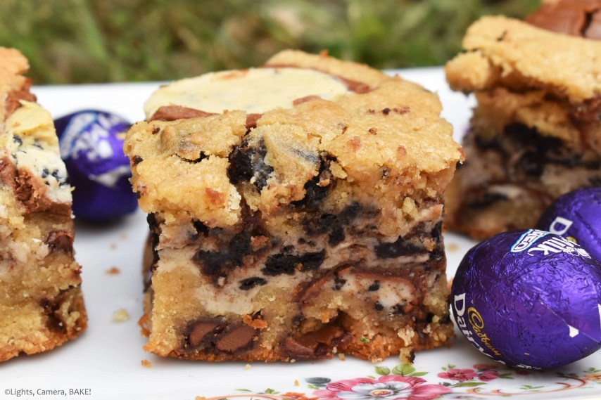 Oreo Creme Egg Cookie Bars are soft and chewy Easter cookie bars with a twist! Filled with Easter eggs and Oreo Creme Eggs for a cookies and cream flavour, the secret, showstopping element to these cookie bars is the Oreo Creme Egg cheesecake filling running through the middle of these cookie bars! #eastereggcookies #cremeeggrecipe #oreocheesecake #oreocheesecookiebars #eastereggcookiebars #cremeeggbars