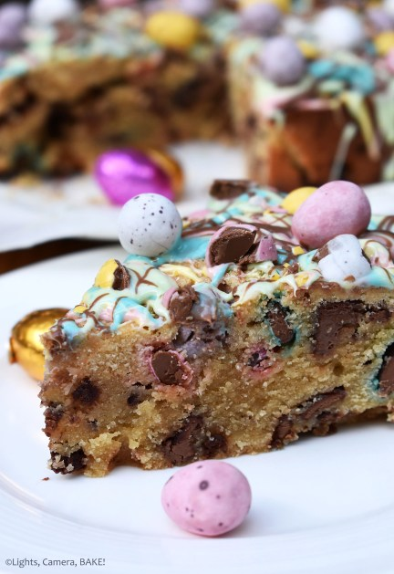 Mini Egg Cookie Pie or cookie cake depending on what you like to call them. A vanilla cookie pie filled with chocolate chips, Easter eggs and Easter mini eggs and topped with a rainbow coloured white chocolate drizzle. #eastercookies #minieggcookies #minieggcookiepie #minieggcookiecake #minieggcake #eastereggcookies #eastereggcake