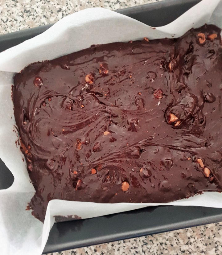 Brownie batter in a baking pan.