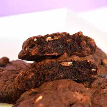 Bakery triple chocolate cookie in half.